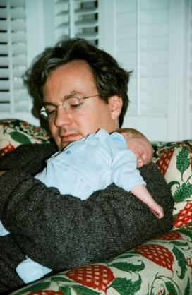 Baby Cormack asleep on Julian